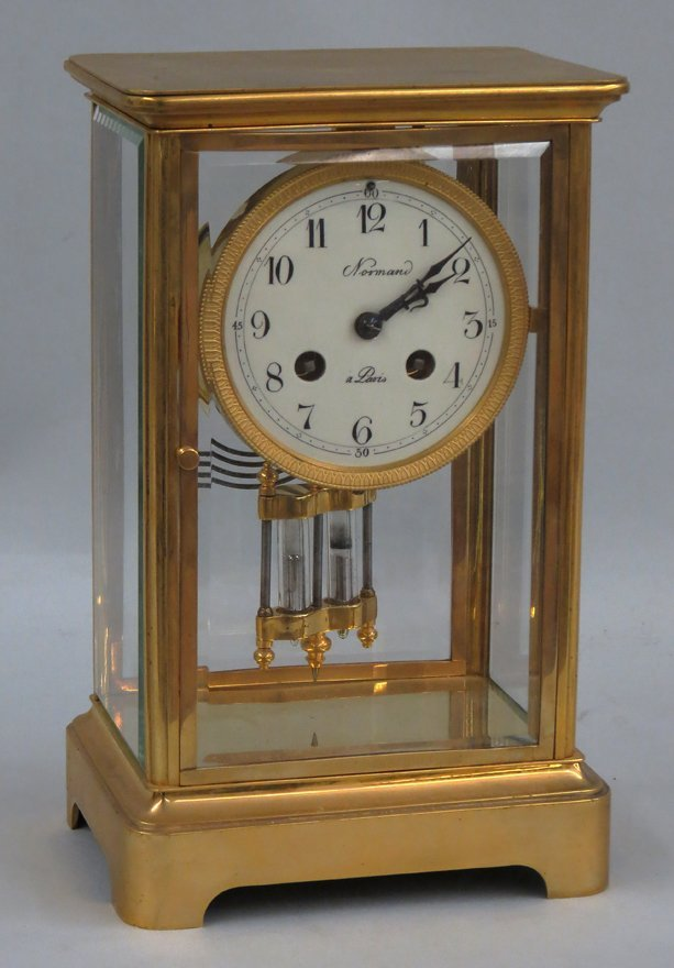 FRENCH BRASS AND GLASS MANTEL CLOCK