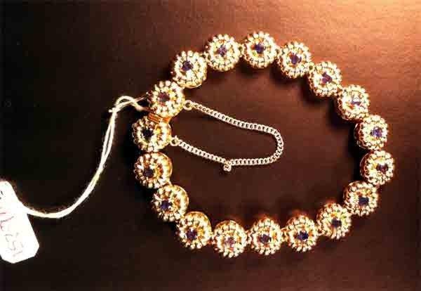 90996: Tiffany & Co 18k Gold + Sapphire Bracelet