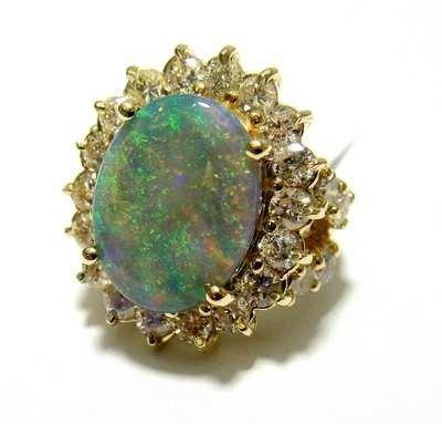 4: 3.50ct Diamond & 5.46ct Opal on 14KT Gold Ladies R