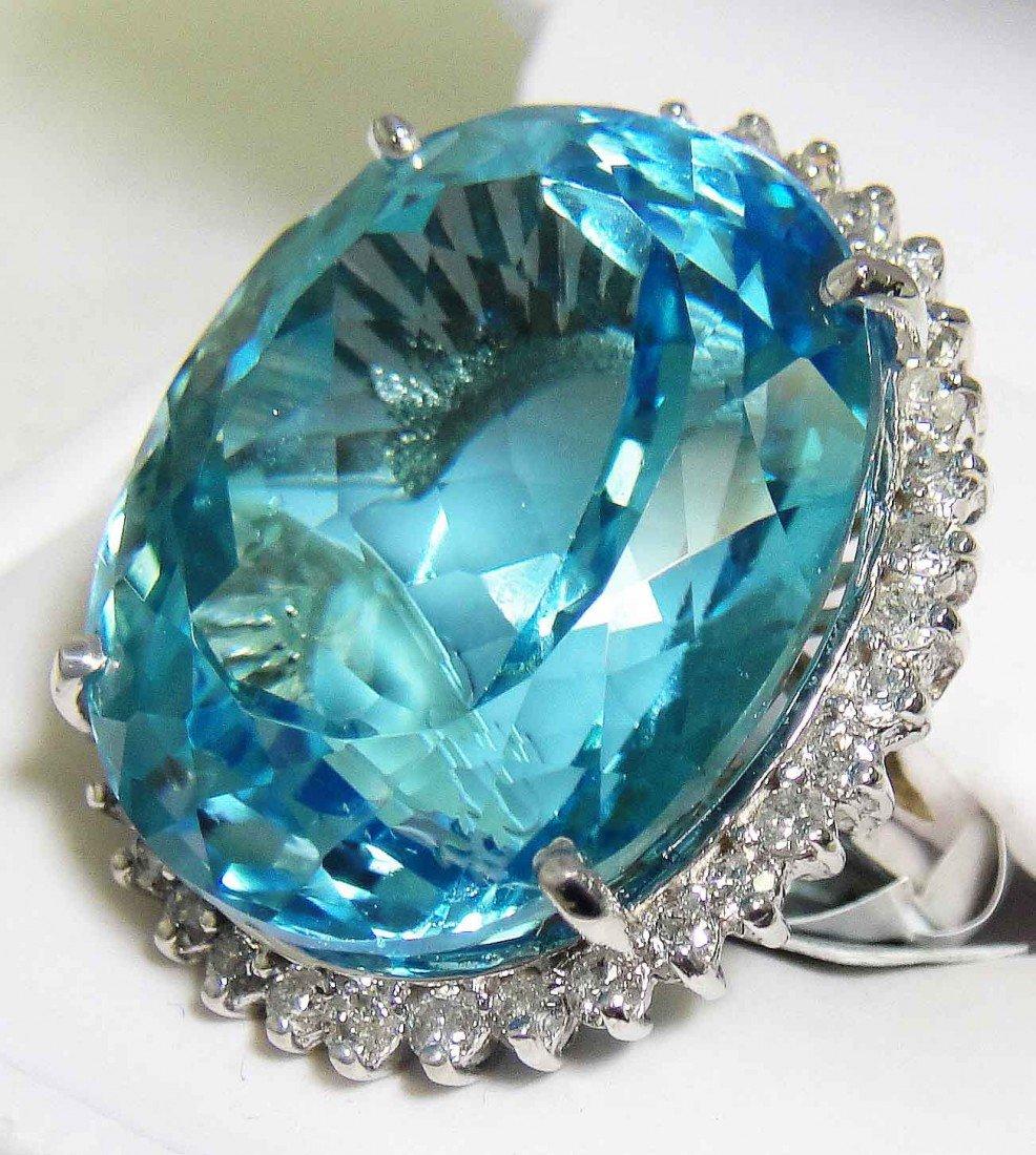 74.19ct Blue Topaz & 1.38ct Diamond 14KT White Gold Rin