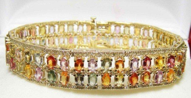 28D: 24.40ct Sapphire & 3.09ct Diamonds 14KT Gold brac