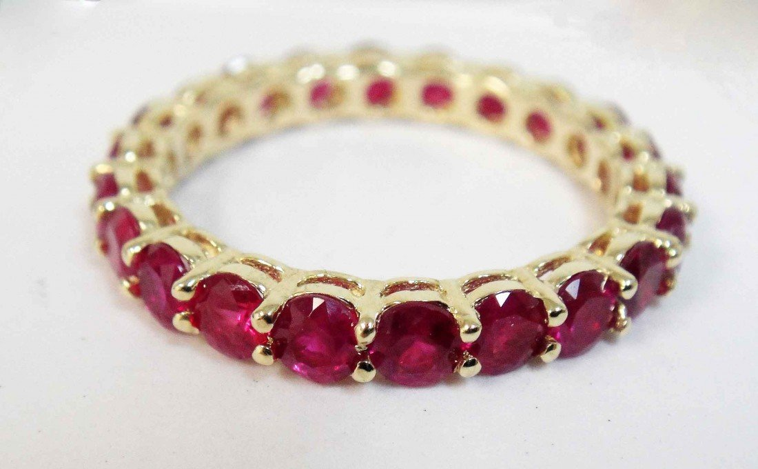 3.01ctw Ruby set in 14KT Gold Eternity Ring