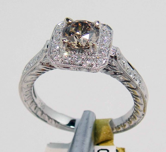 14R: 1.07ctw (0.70ct SI-2 CNTR) Diamond 18KT Gold Ring