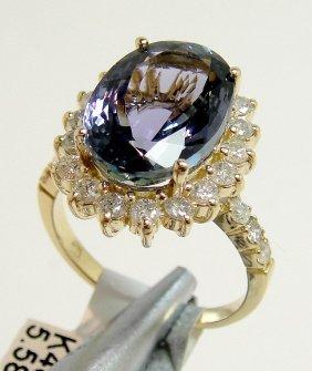 5.58ct Tanzanite & 0.92ctw Diamond 14KT Gold Ring