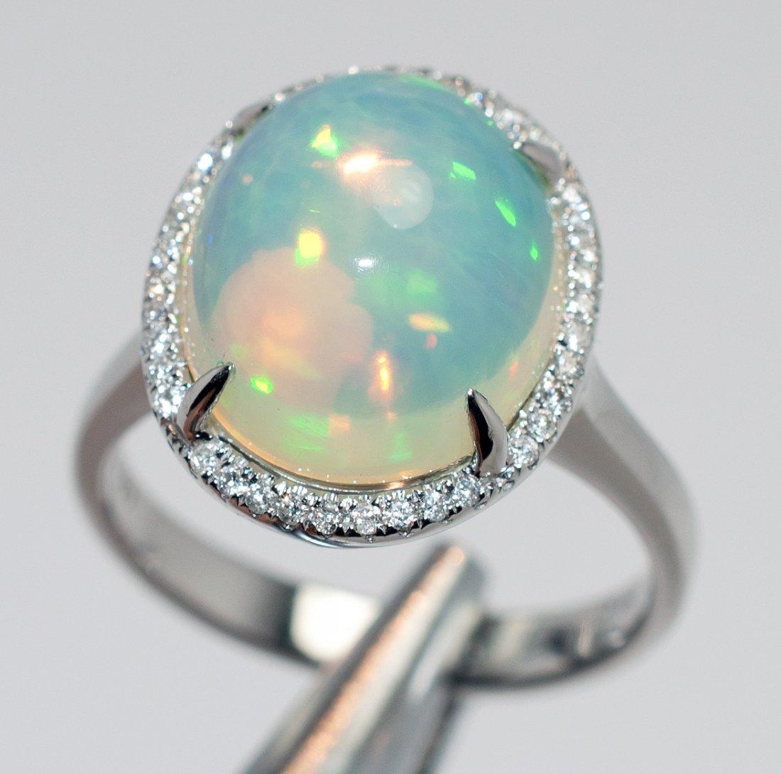 3E: 4.61ct Jelly Australian Opal & .16ct diamond 14KT R