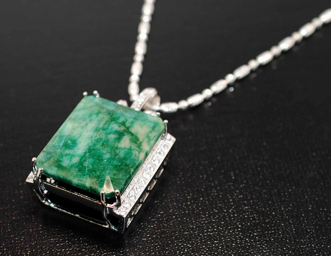 112.83ct Emerald & 2.15ct CL Sap. Platinum Plated Penda