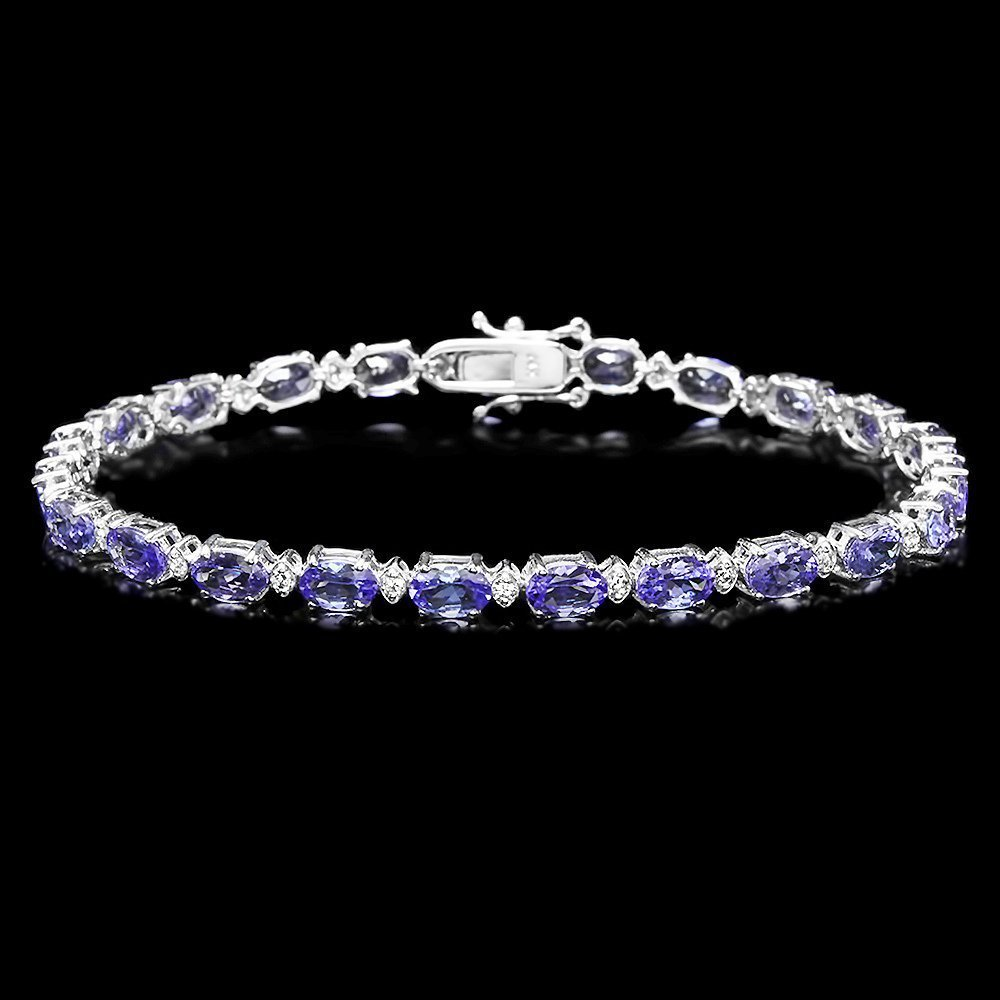 1A: $8500 CERTIFIED 14K WHITE GOLD 10CT TANZANITE 0.6