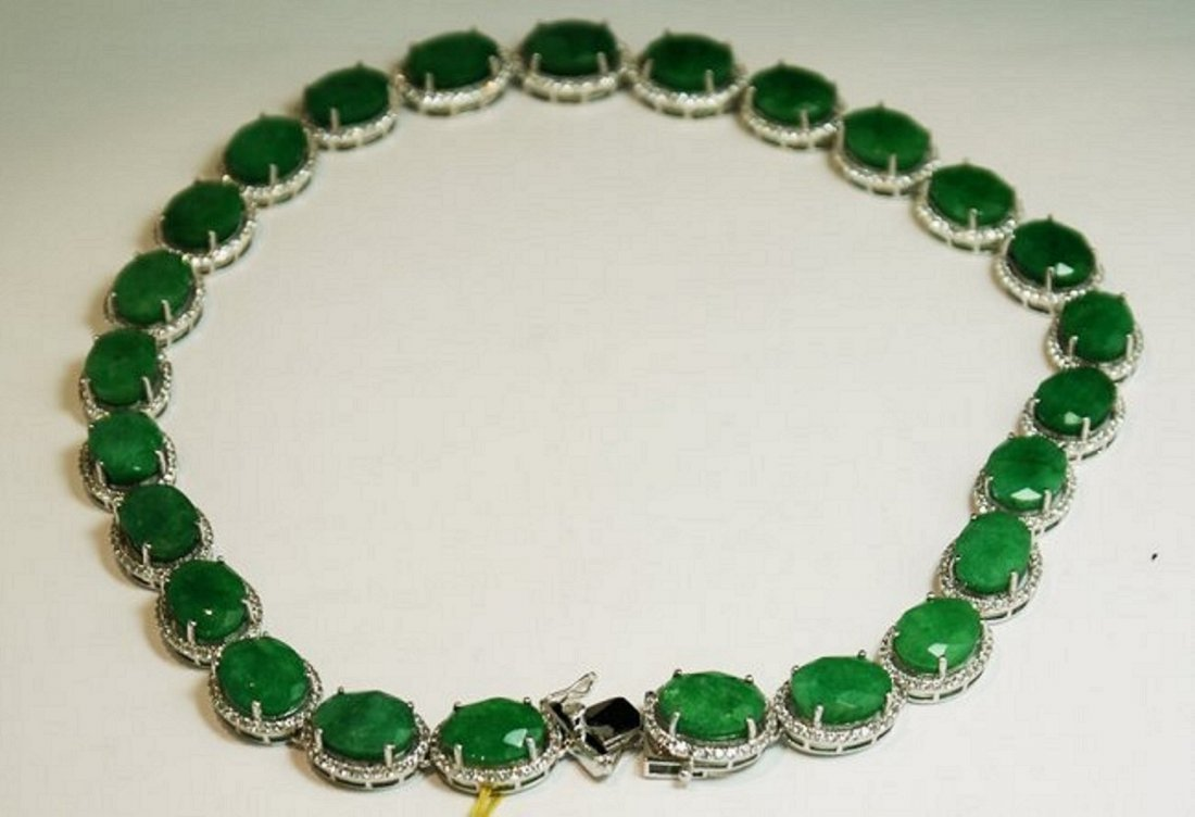 167.59 ctw. Emerald 11.37 ctw. Sapphire