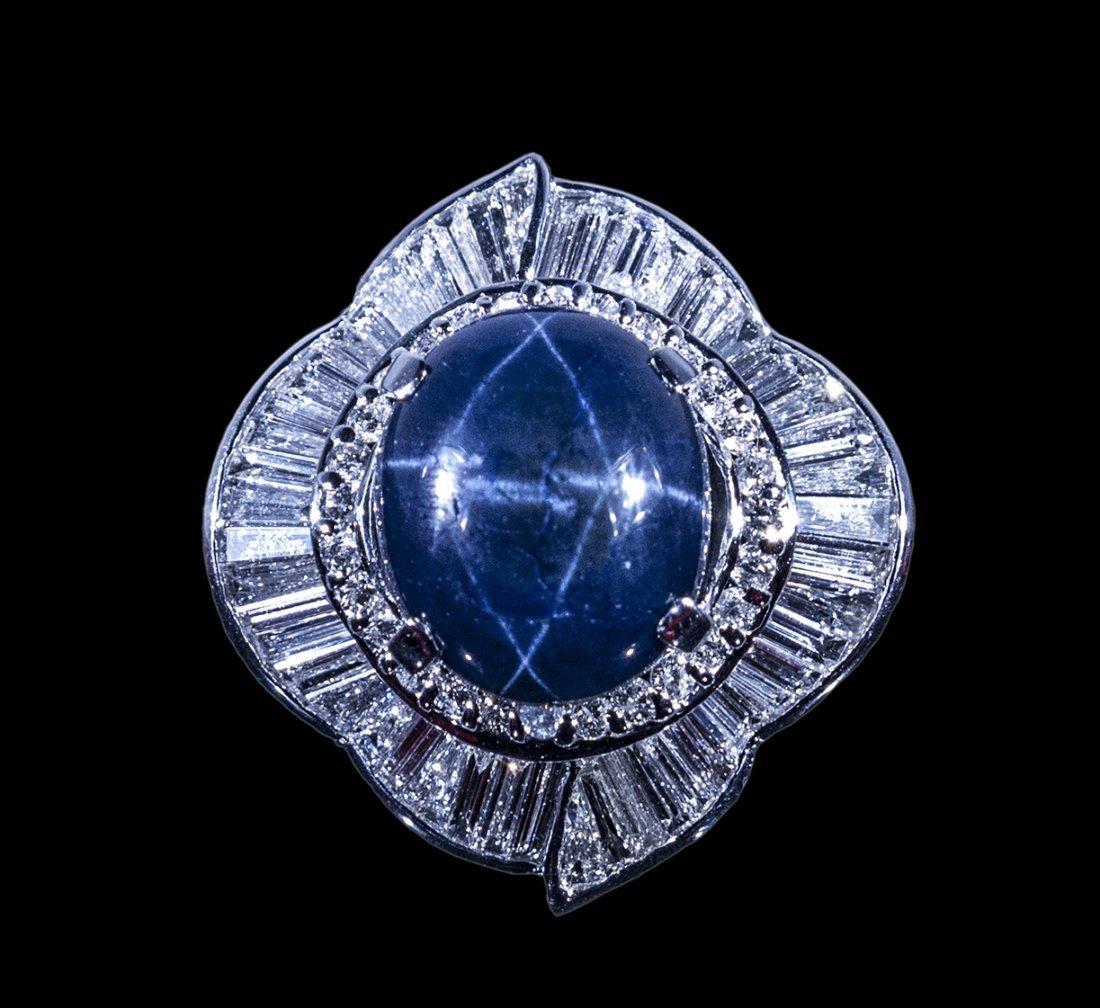 18k WG 23.43ct. Star Sapphire 5.65cts Dia RN WL40008