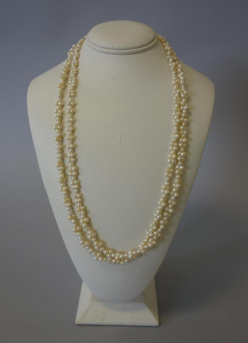 Long Single Strand Pearl Necklace