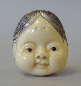 10B: Carved Ivory & Polychrome Netsuke, 2 Faces, signed