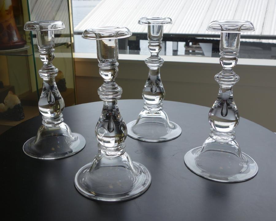 A set of 4 Steuben Teardrop Glass Candlesticks