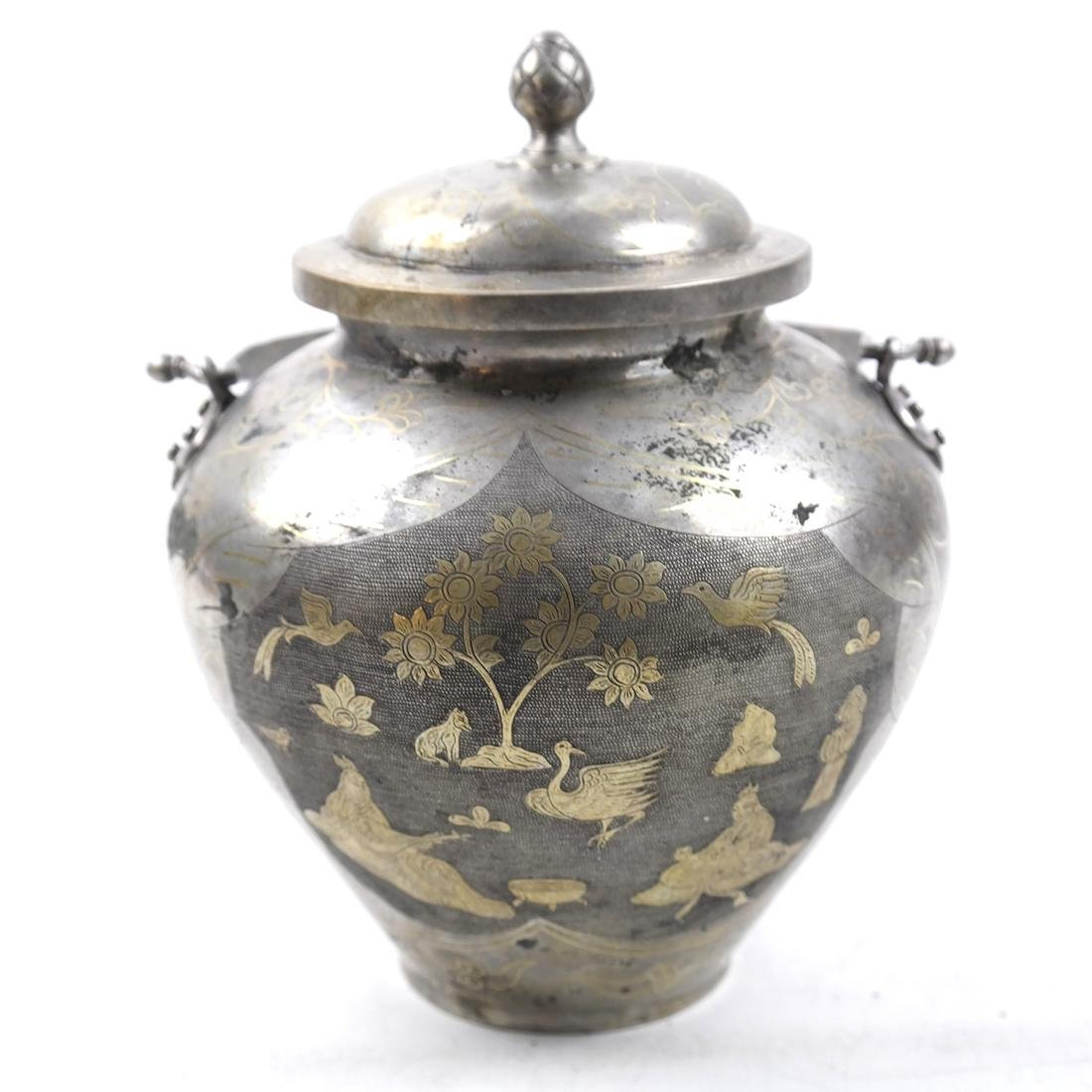 AN ASIAN PARCEL-GILT SILVER BALUSTER JAR AND COVER