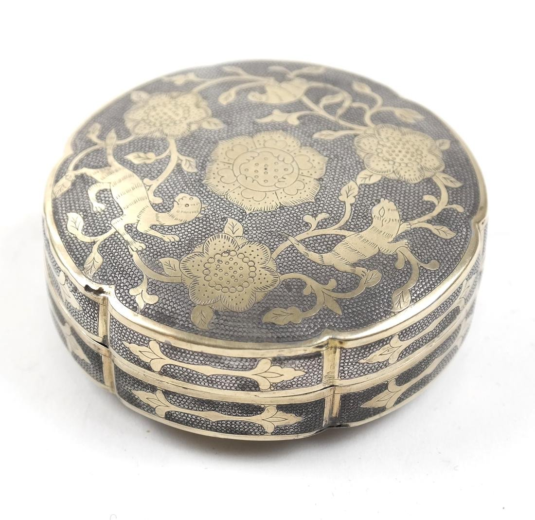AN ASIAN PARCEL-GILT SILVER HEXAFOIL BOX AND COVER