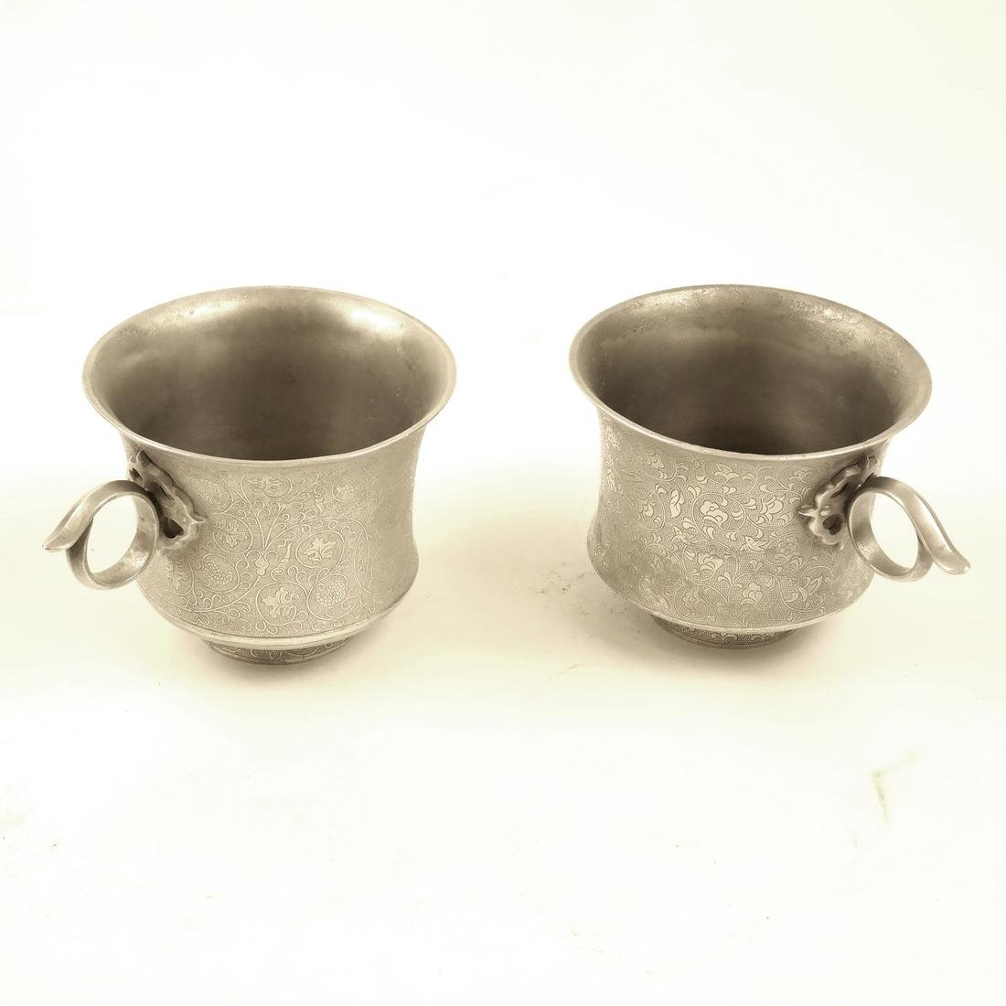 A PAIR OF SMALL SILVER WAISTED CUPS