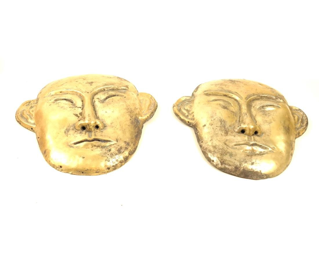 A PAIR OF LARGE SILVER-GILT FUNERARY STYLE MASKS