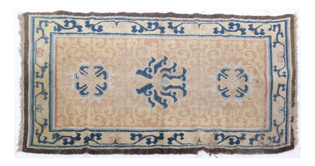 A CHINESE RUG 19TH CENTURY