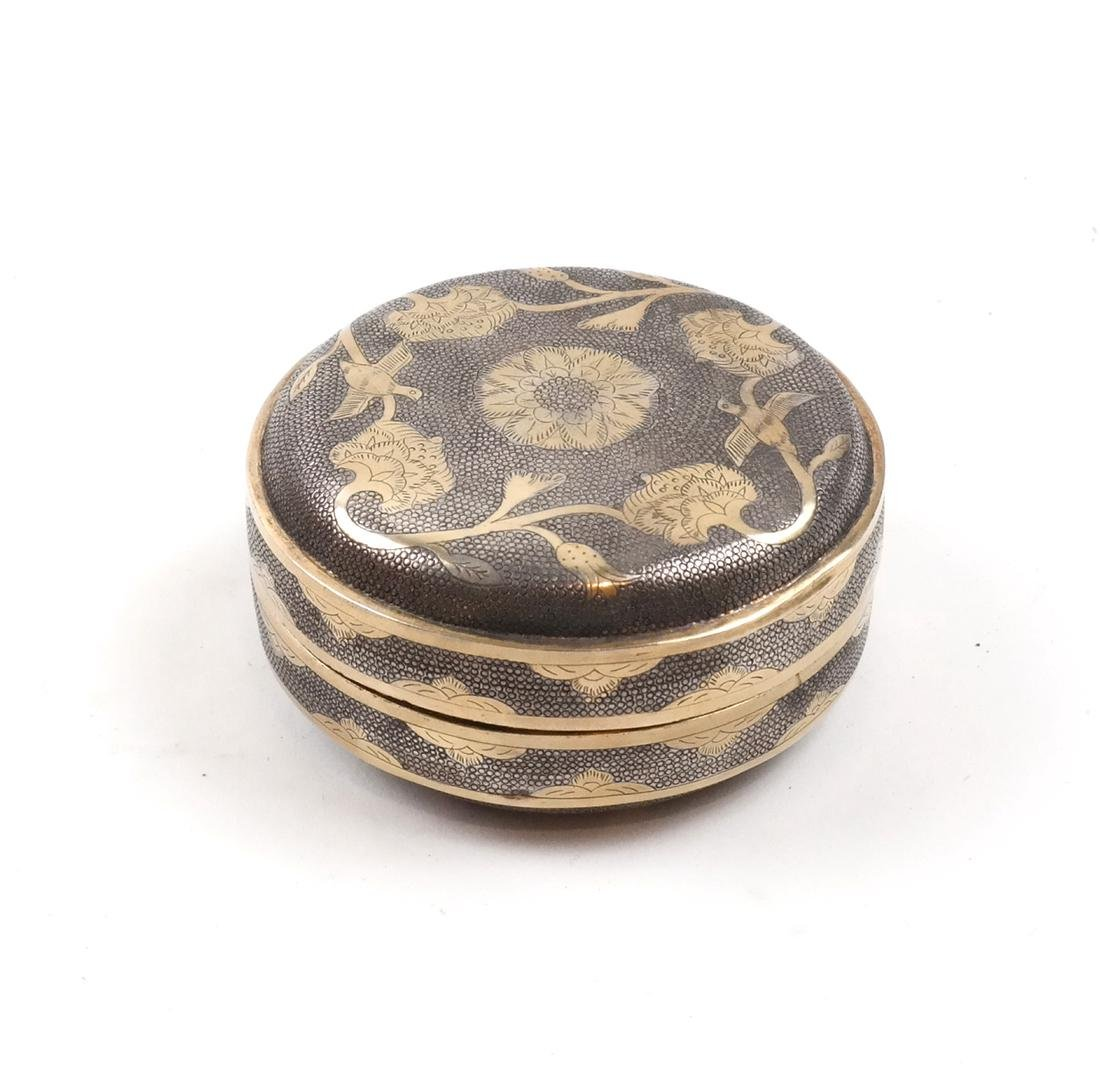 A SMALL PARCEL-GILT SILVER CUSHION-FORM BOX AND COVER