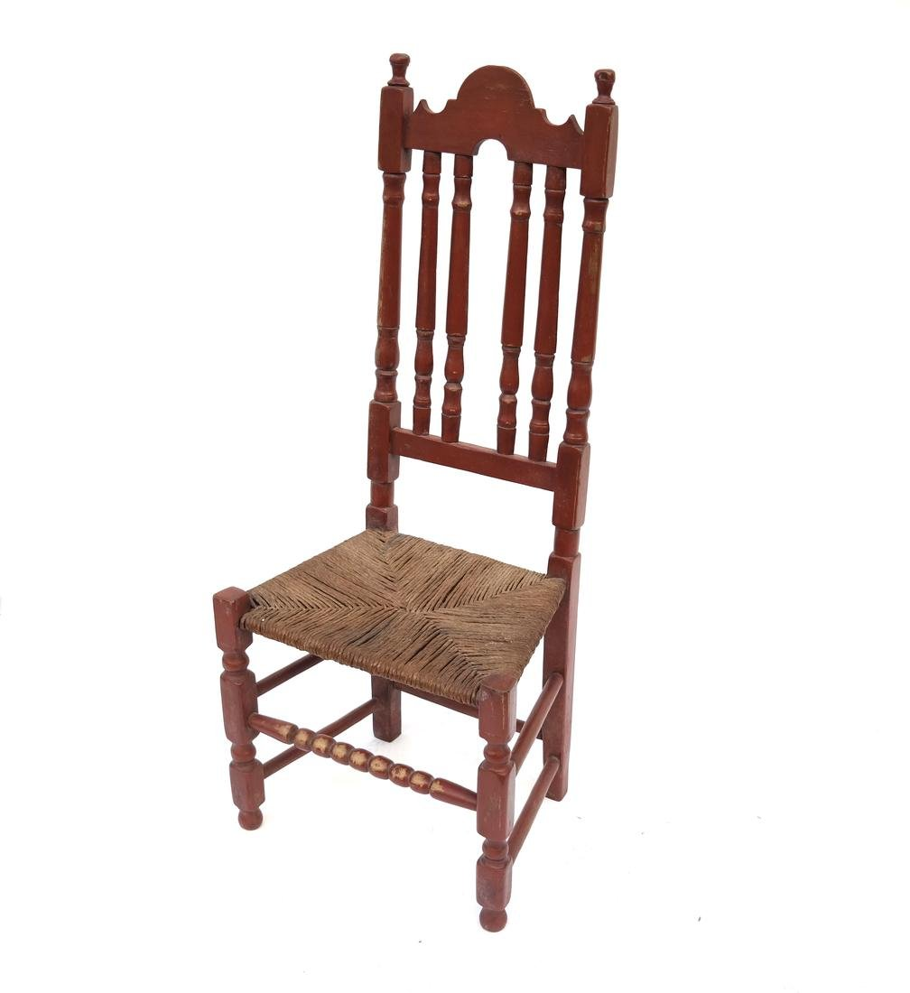 A RED-PAINTED TURNED-MAPLE BANNISTER-BACK SIDE CHAIR,