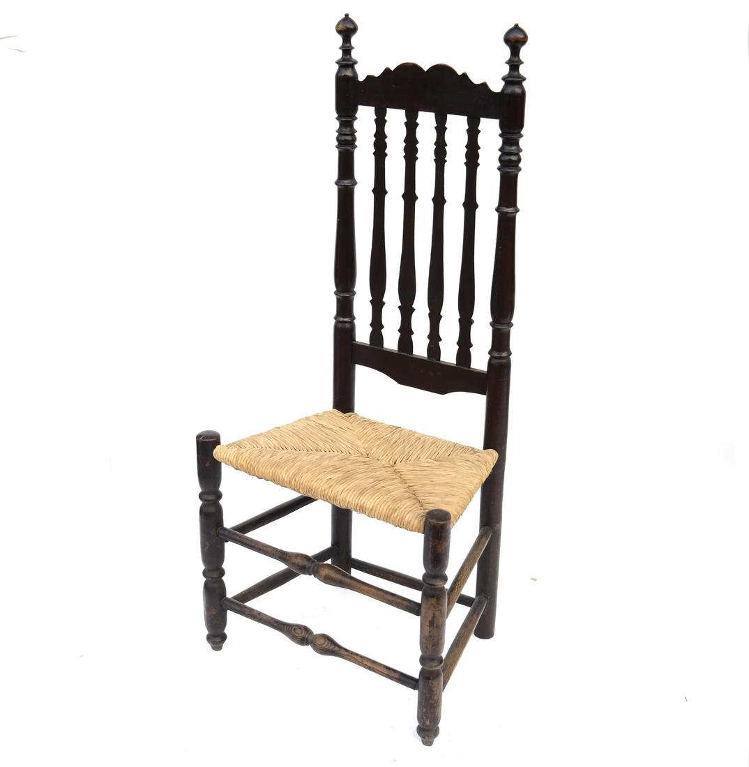BLACK-PAINTED BANNISTER-BACK SIDE CHAIR, 18TH C