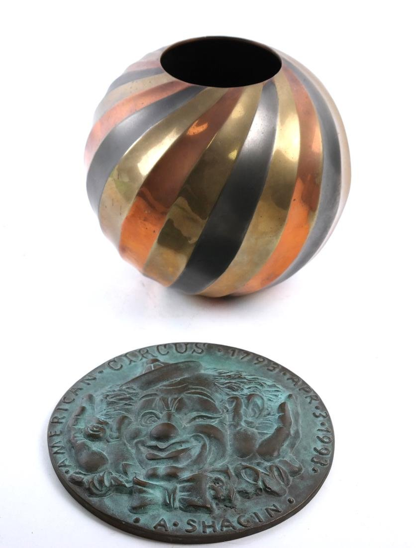 Clown Disk and a Metal Vase