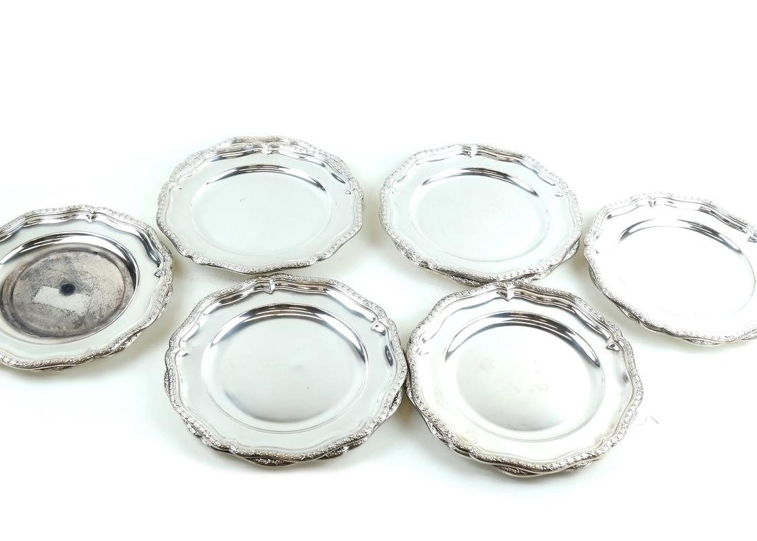Twelve Silver-Plated Plates