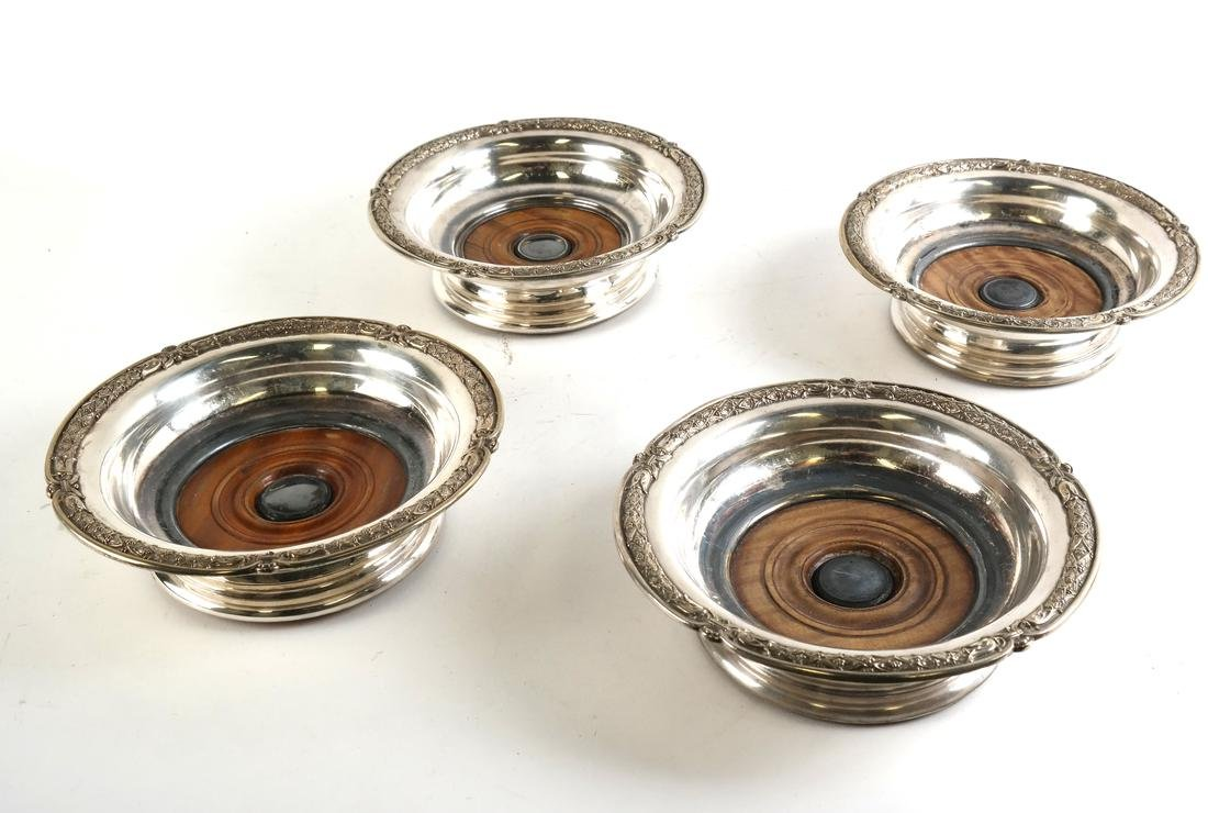 Four Silver-plated Wine Coasters