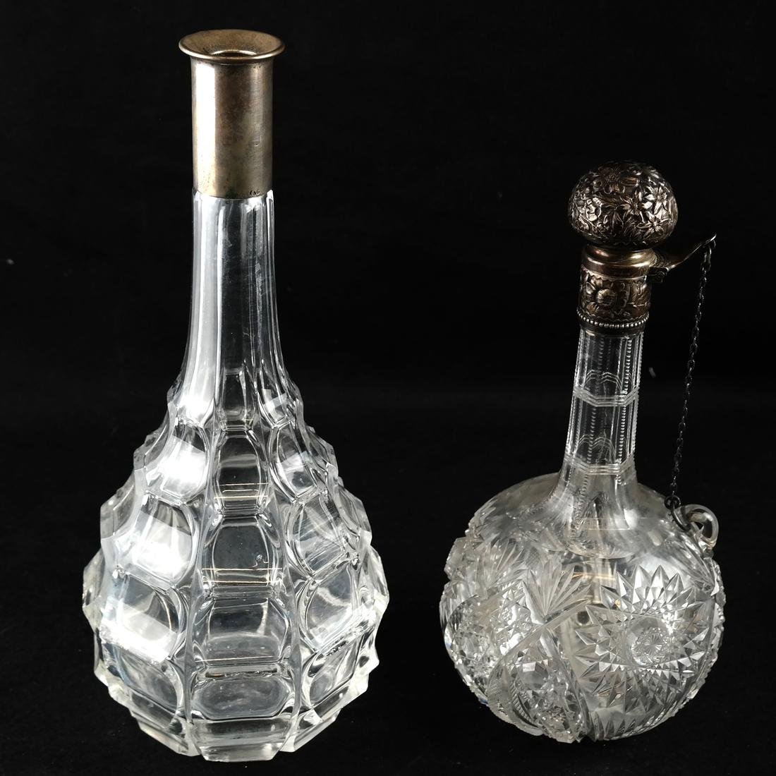 Two Sterling Mounted Glass Decanters