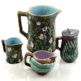 Four Majolica Various Pitchers