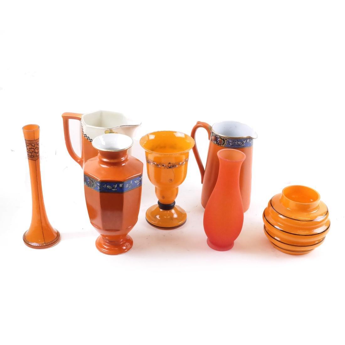 Seven Assorted Glass and Porcelain Orange Vessels