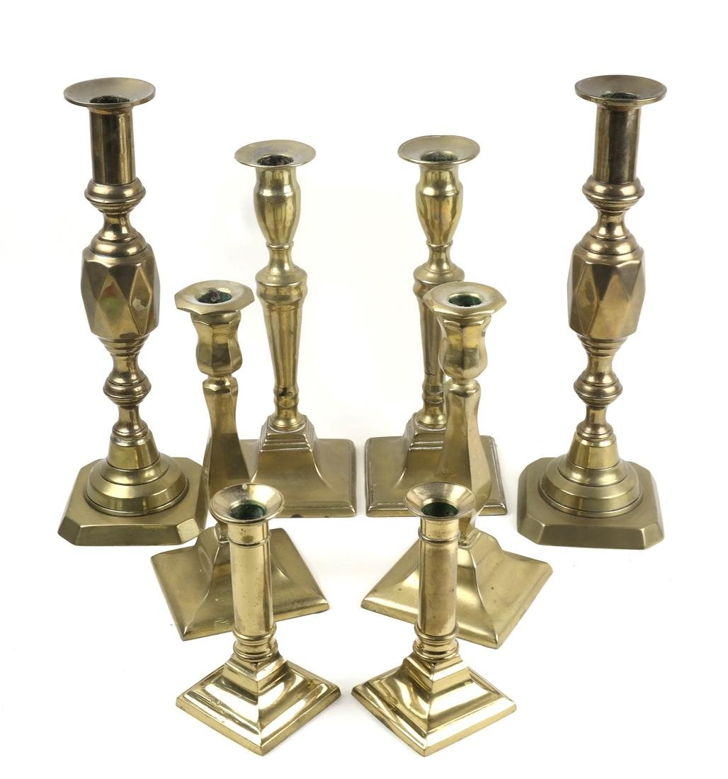 Four Pairs of Brass Candlesticks