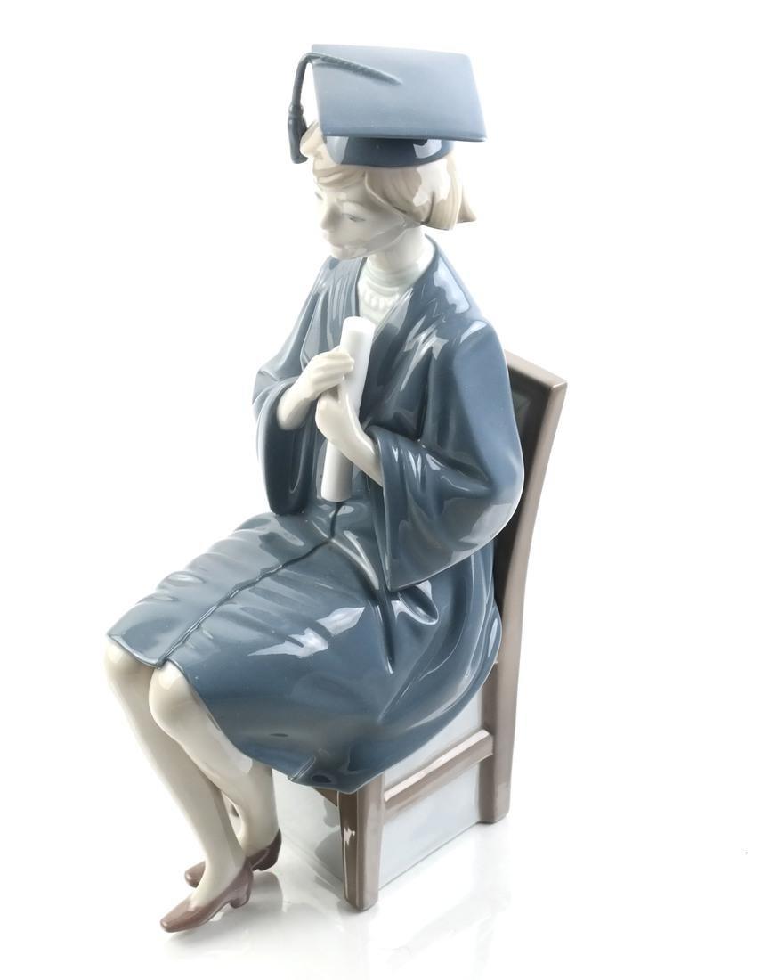 Lladro: Seated Figurine of a Female Graduate