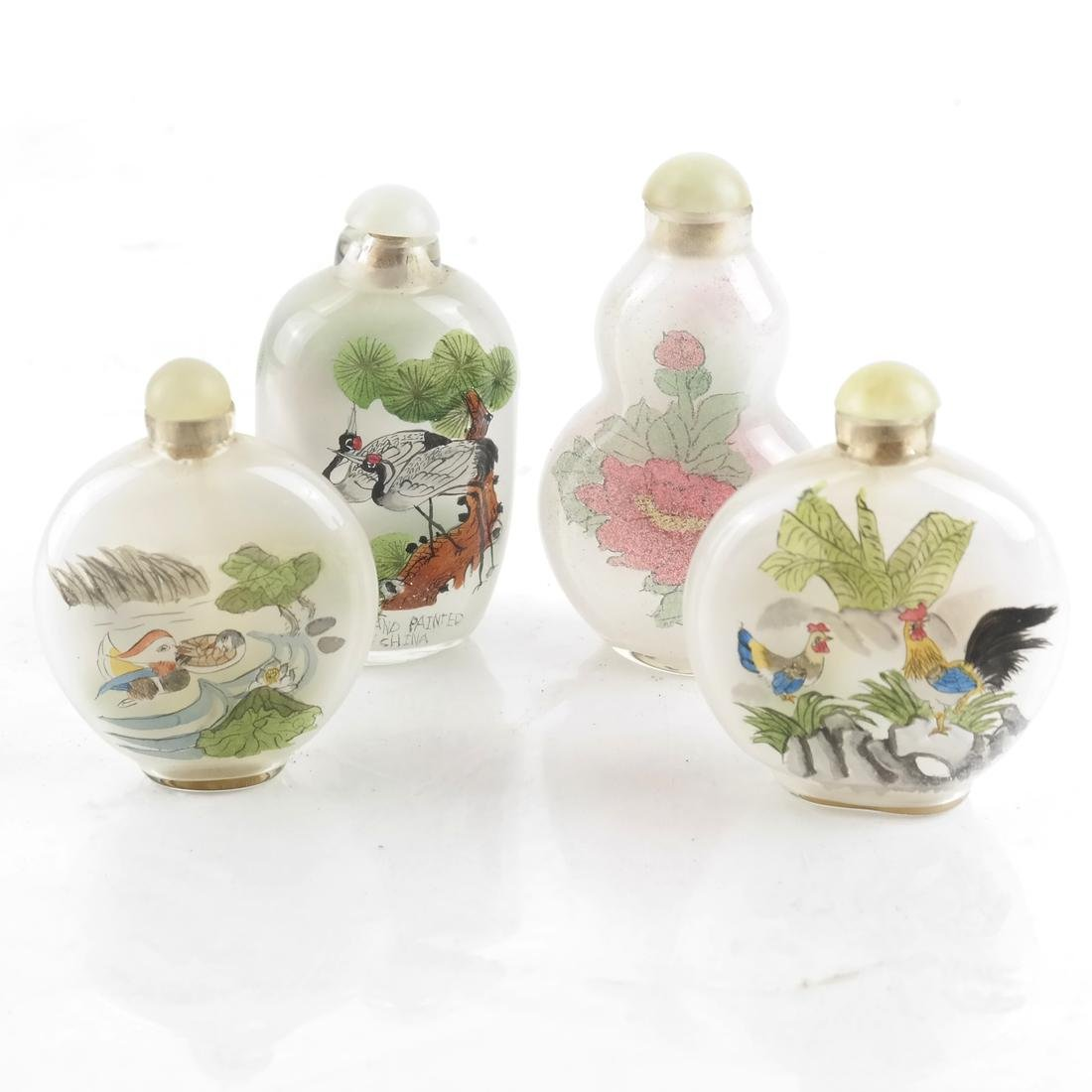 Four Decorated Glass Snuff Bottles
