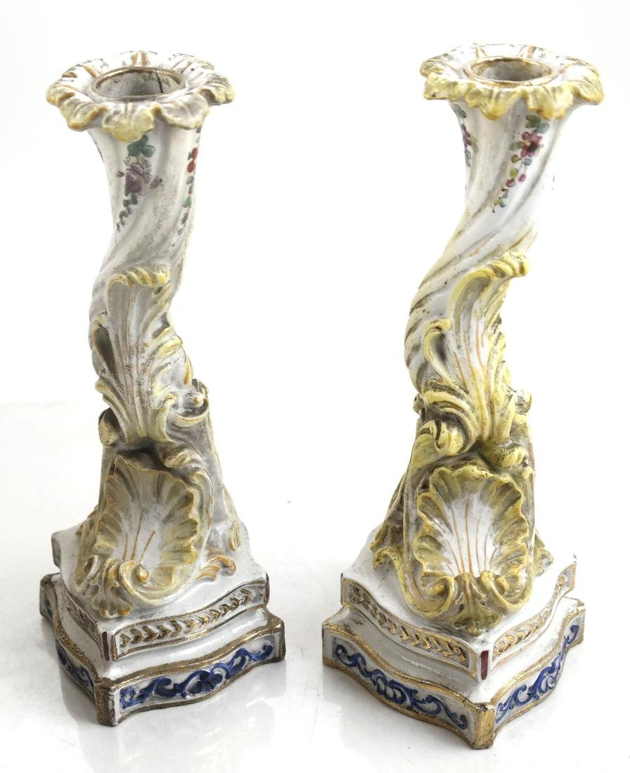 Pair of Bisque Porcelain and Enamel Candlesticks
