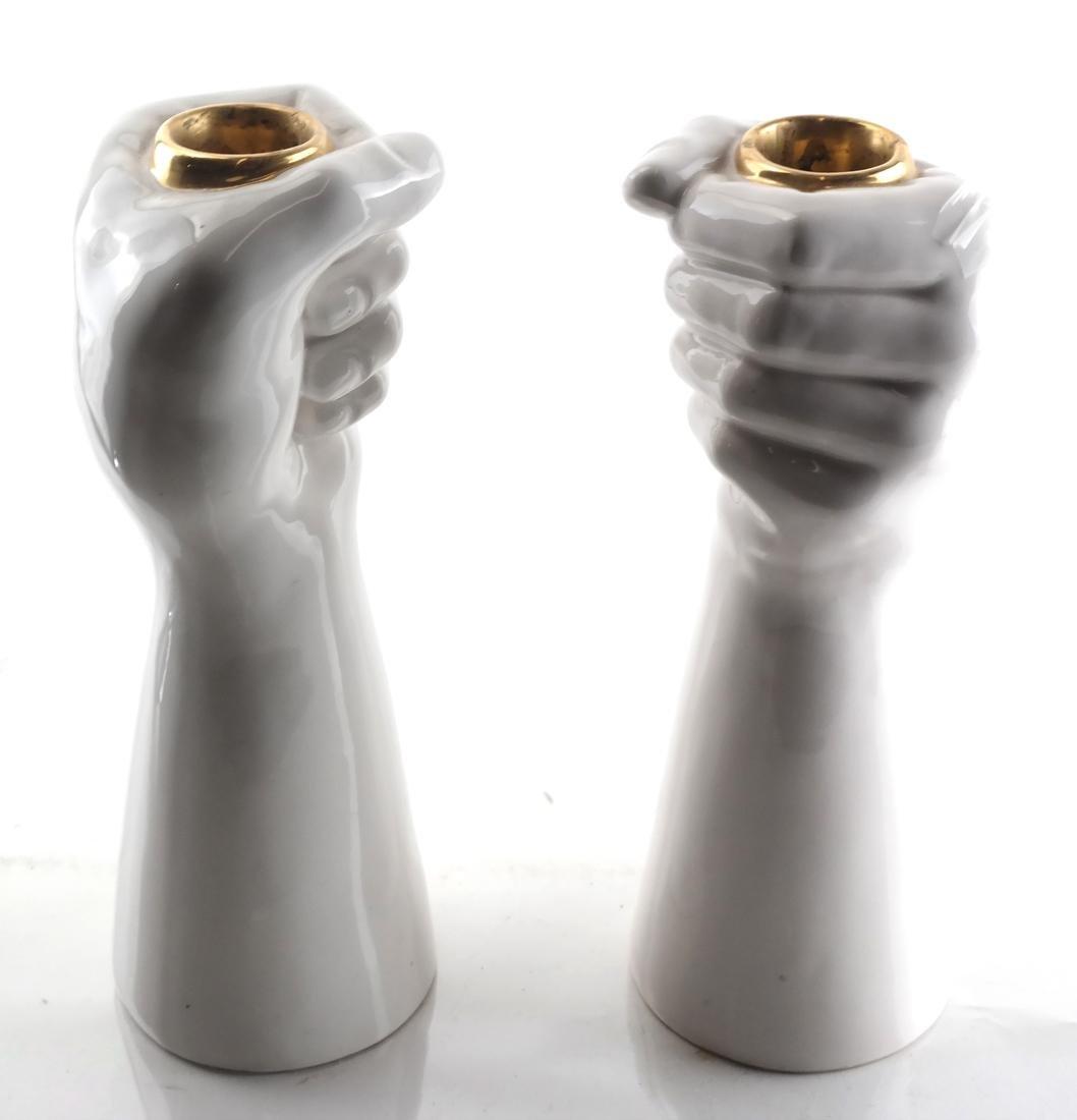 Pair of White Ceramic Fist-Form Candlesticks