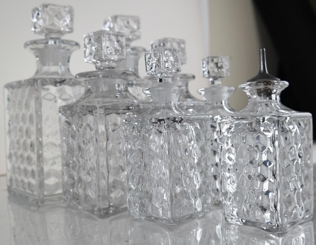 Seven Glass Crystal Decanters