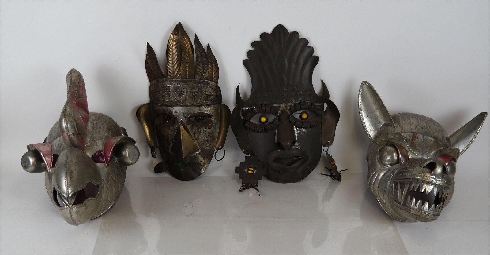Four Tin Tribal Masks