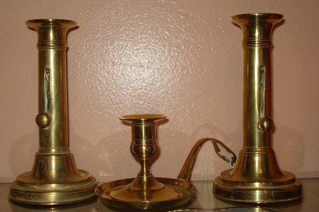 65: Pair of English Brass Push-Up Candlesticks