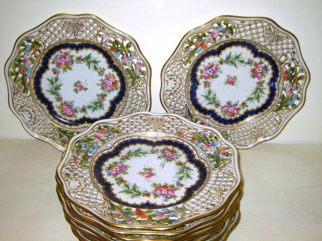 90: 11 Reticulated Hand Painted Floral Plates
