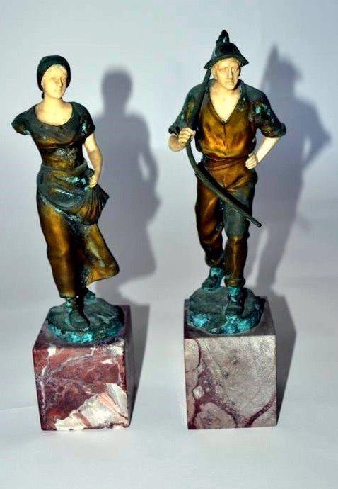 244: Pair of Schmidt Felling Figures