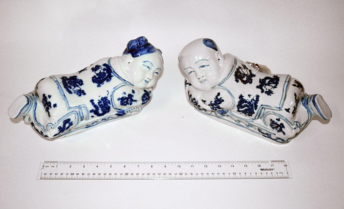 180: Pair of Chinese Blue and White Figural Headrests