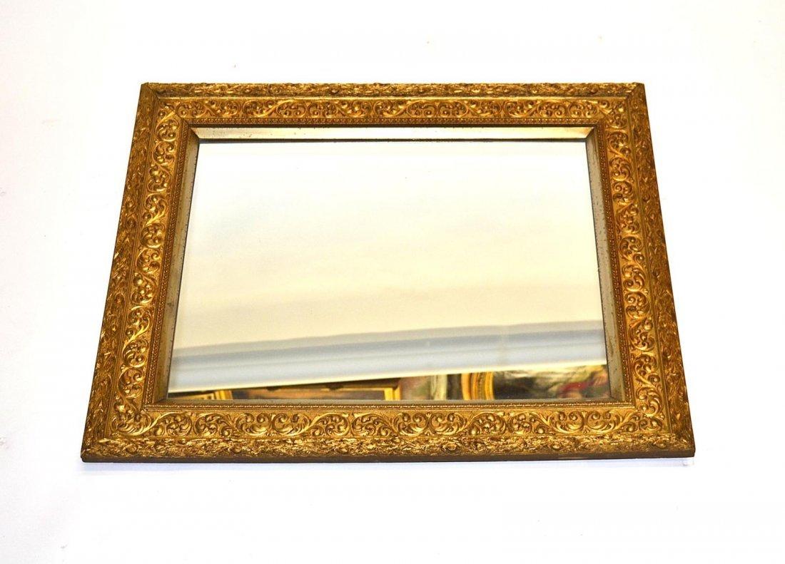 64: Gilt Carved Mirror