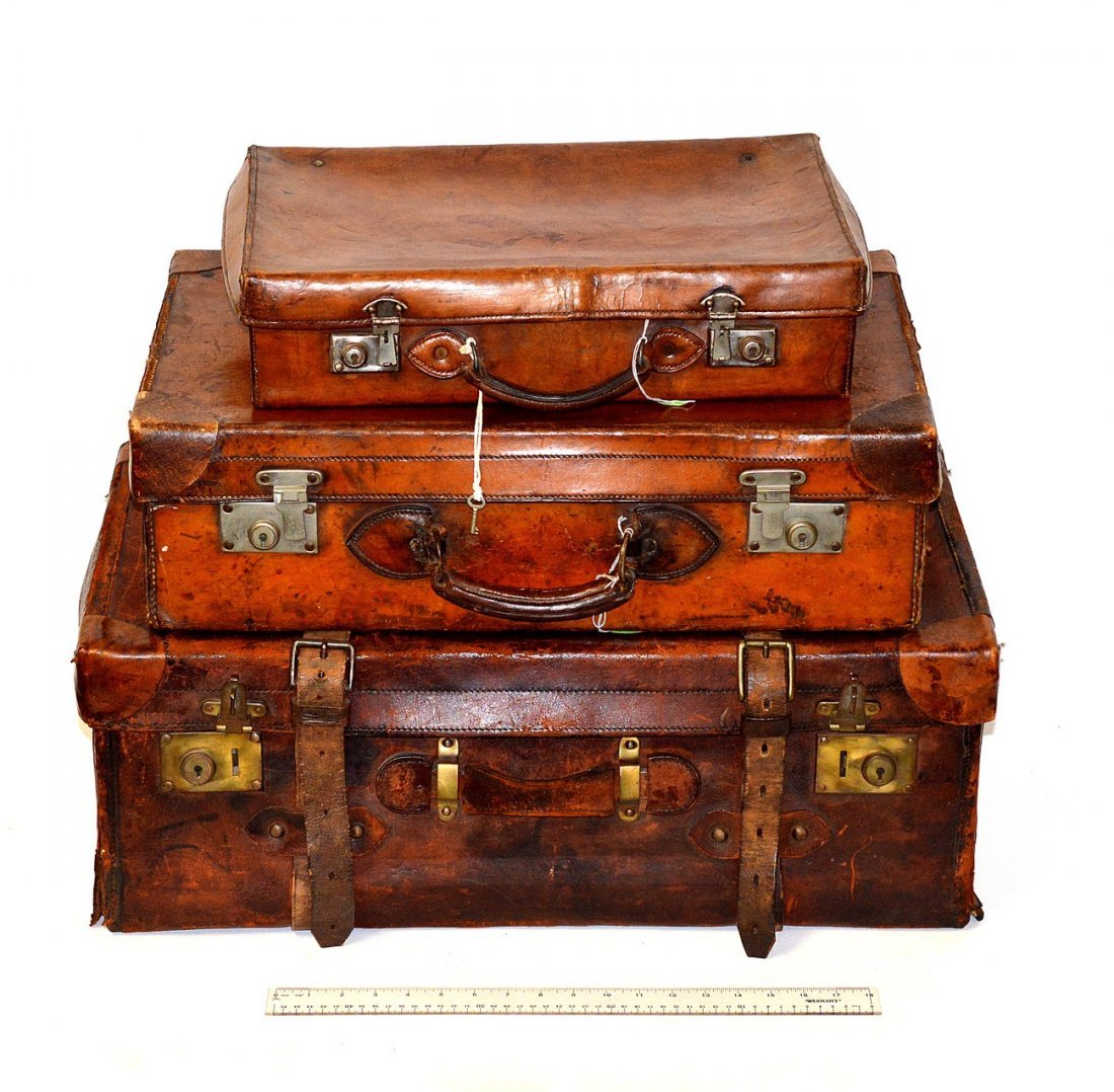 5: Three Vintage Leather Luggage Articles