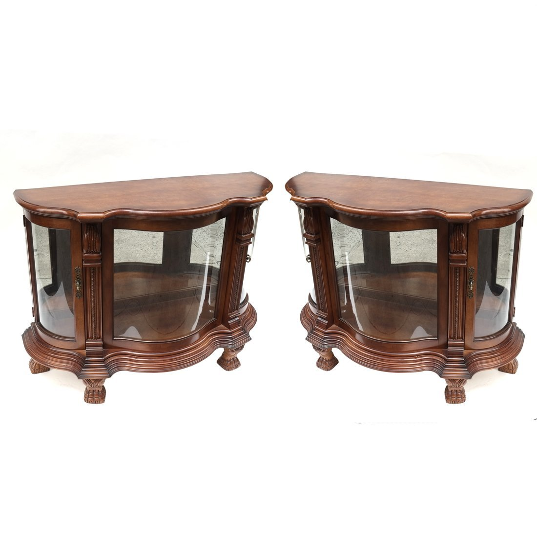 A Pair of Serpentine Cabinets