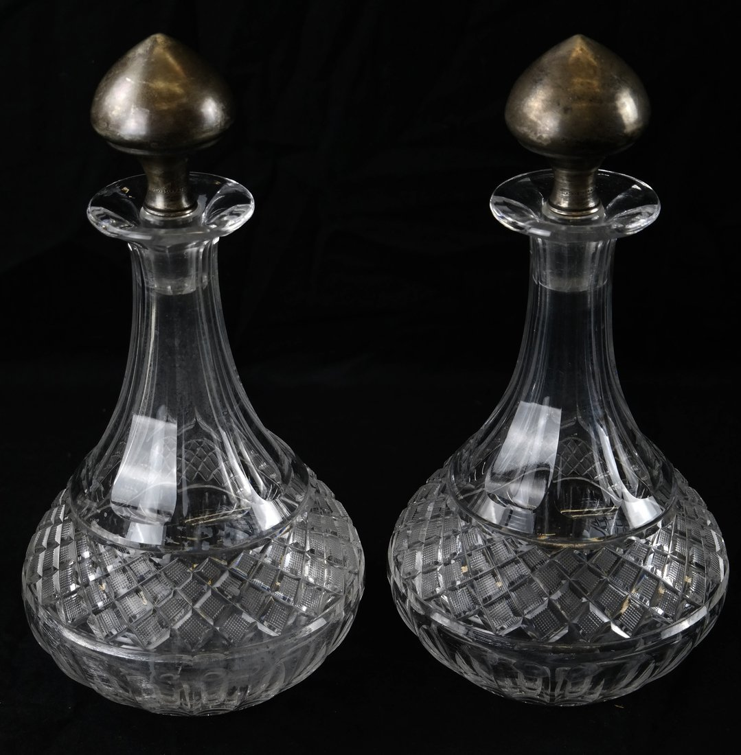 Two Sterling Mounted Crystal Decanters