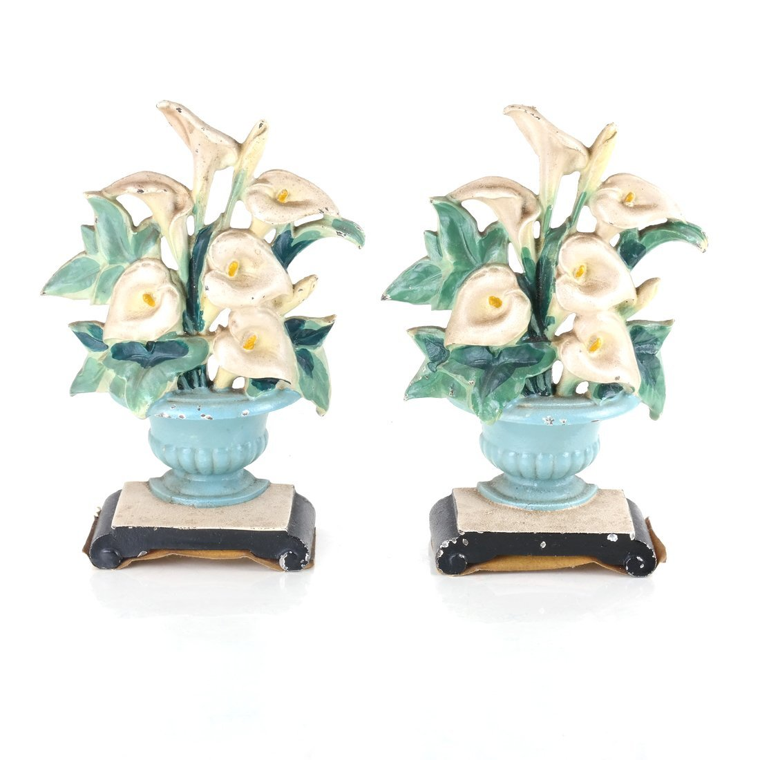 Two Identical Cast Iron Lilies in Urns Doorstops