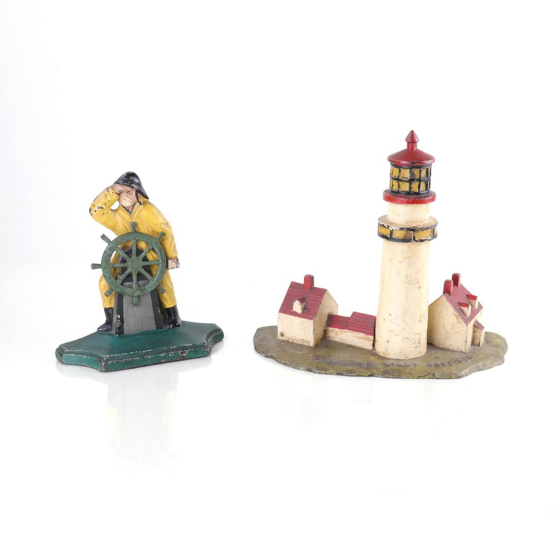 Two Painted Cast Iron Nautical Doorstops