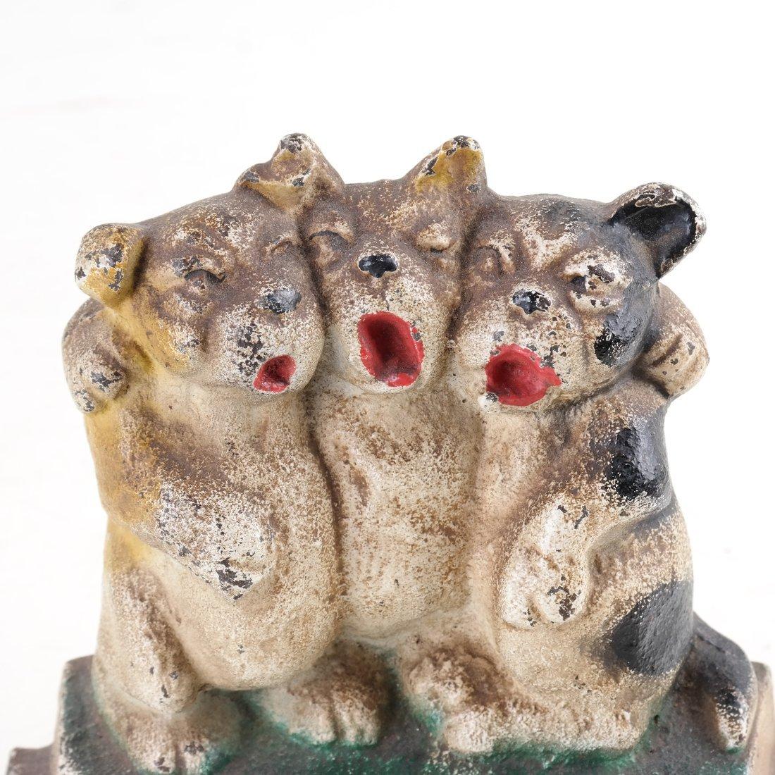 Three Cast Iron Pup Groups - 9