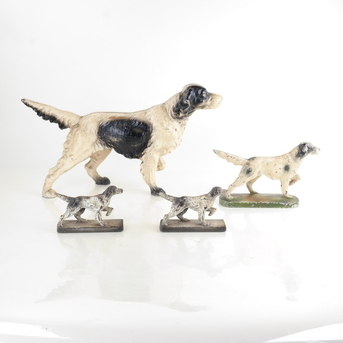 Four Painted Cast Iron Dogs