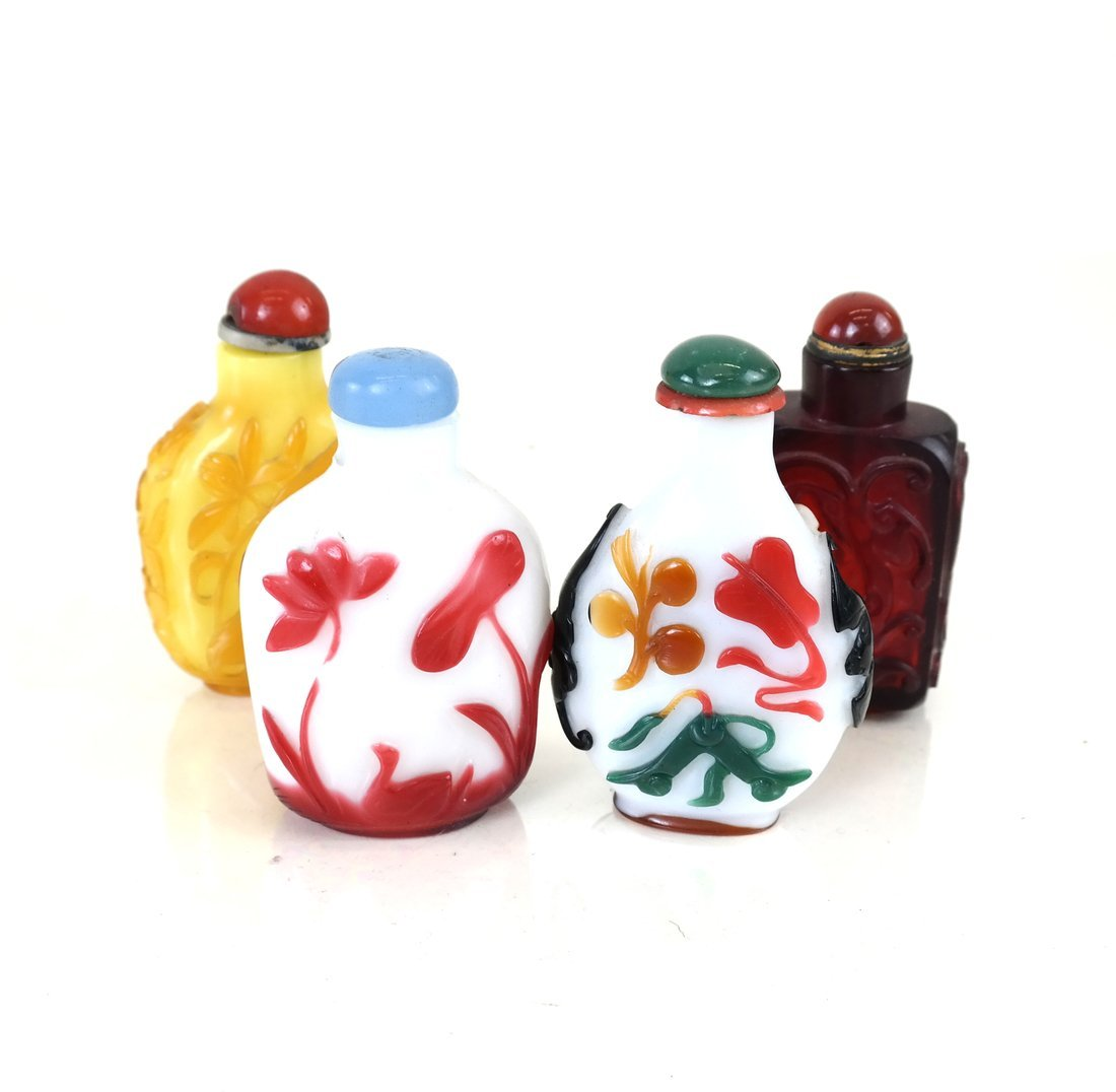 Four Chinese Peking Glass Snuff Bottles
